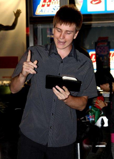 Ryan Hemelaar preaching the Bible