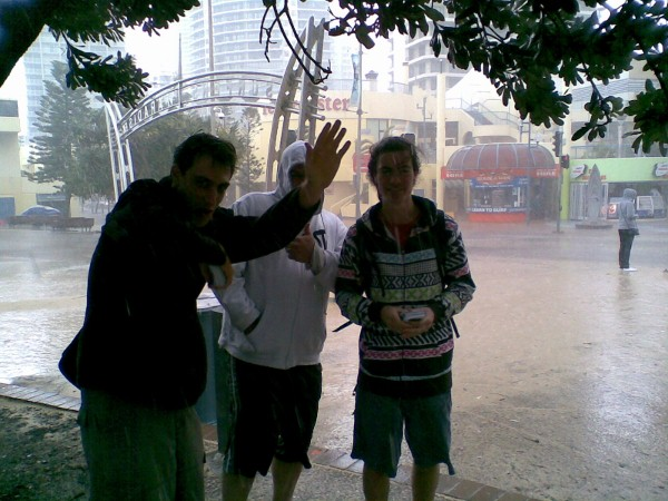 Blake, Jeremy, and Joel standing in the rain where we usually preach