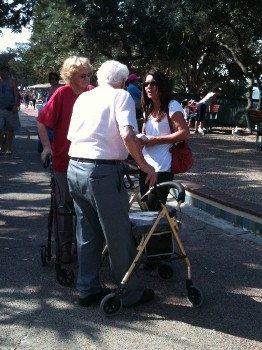 Glenda talking to an older couple