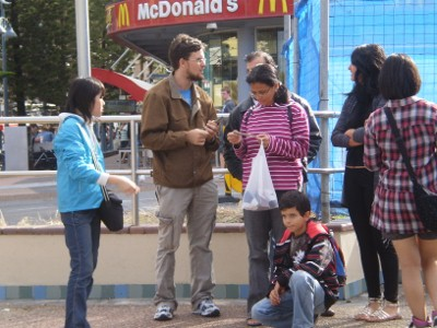 Yarran chatting to a group of people