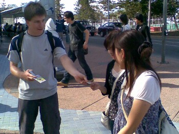 Ryan Hemelaar handing out gospel tracts at Surfers Paradise
