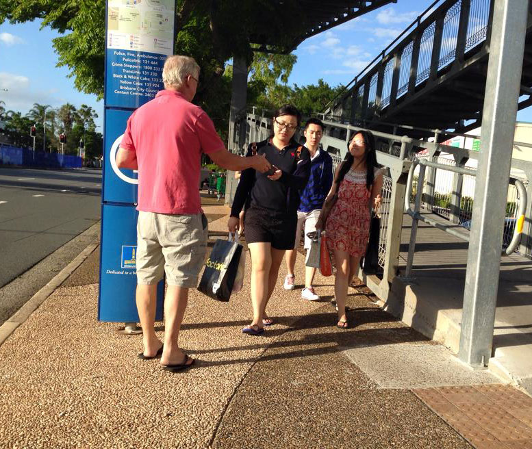 Handing out gospel tracts at bus stop